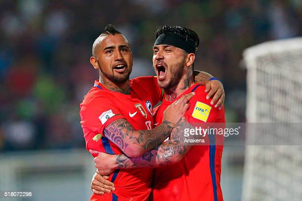 Arturo Vidal of Chile celebrates with teammate Mauricio Pinilla after scoring the third goal of his team during a match between Venezuela and Chile...