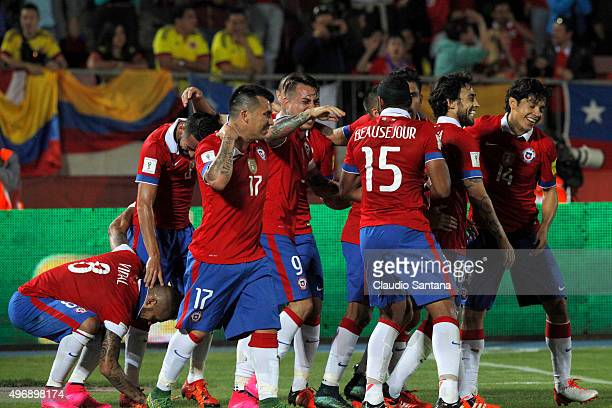 Arturo Vidal of Chile celebrates with teammates after scoring the opening goal during a match between Chile and Colombia as part of FIFA 2018 World...