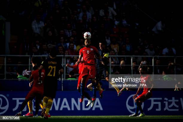 Arturo Vidal of Chile competes with Tim Cahill of Australia during the FIFA Confederations Cup Russia 2017 group B football match between Chile and...