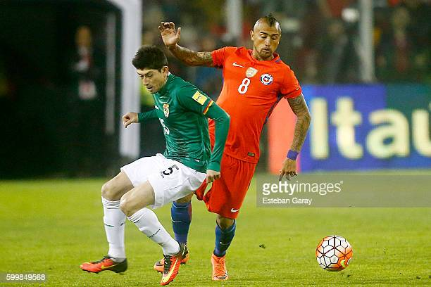 Arturo Vidal of Chile fights for the ball with Nelson Cabrera of Bolivia during a match between Chile and Bolivia as part of FIFA 2018 World Cup...