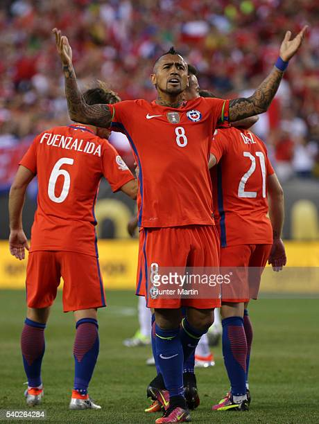 Arturo Vidal of Chile gestures to the fans after a goal scored by Eduardo Vargas during a group D match between Chile and Panama at Lincoln Financial...
