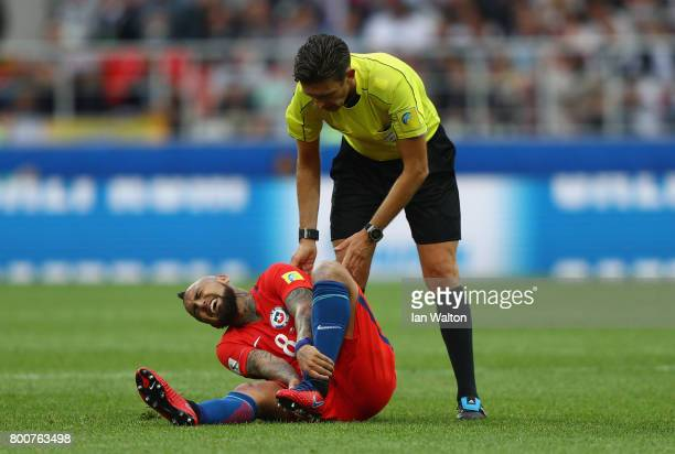 Arturo Vidal of Chile grimaces with referee Gianluca Rocchi during the FIFA Confederations Cup Russia 2017 Group B match between Chile and Australia...