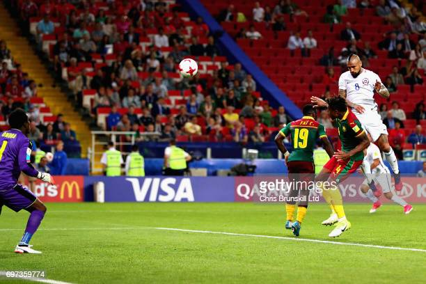 Arturo Vidal of Chile heads the ball past Fabrice Ondoa of Cameroon to score the first goal for Chile during the 2017 FIFA Confederations Cup Russia...