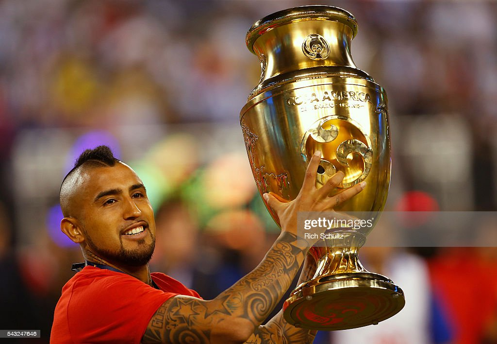 <a gi-track='captionPersonalityLinkClicked' href=/galleries/search?phrase=Arturo+Vidal&family=editorial&specificpeople=2223374 ng-click='$event.stopPropagation()'>Arturo Vidal</a> of Chile holds the trophy after winning the championship match between Argentina and Chile at MetLife Stadium as part of Copa America Centenario US 2016 on June 26, 2016 in East Rutherford, New Jersey, US.