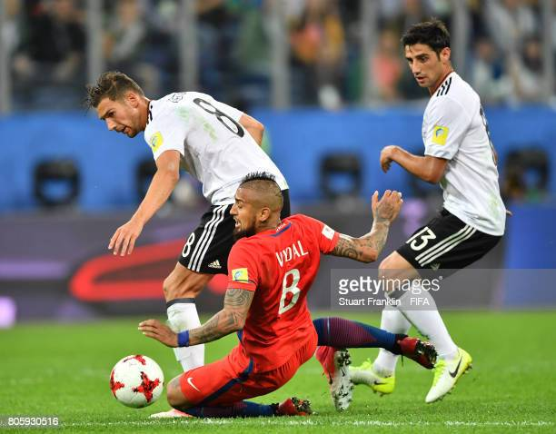 Arturo Vidal of Chile is challenged by Leon Goretzka and Lars Stindl of Germany during the FIFA Confederations Cup Russia 2017 Final match between...