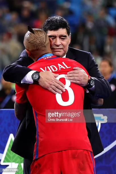 Arturo Vidal of Chile is consoled by Diego Maradona following the FIFA Confederations Cup Russia 2017 Final match between Chile and Germany at Saint...