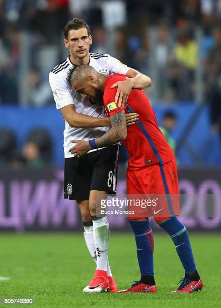 Arturo Vidal of Chile is consoled by Leon Goretzka of Germany after the FIFA Confederations Cup Russia 2017 Final between Chile and Germany at Saint...
