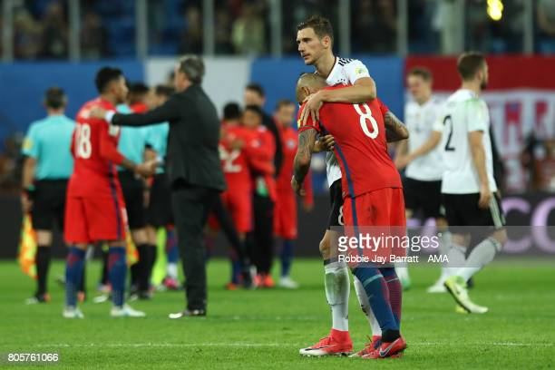 Arturo Vidal of Chile is consoled by Leon Goretzka of Germany at the end of the FIFA Confederations Cup Russia 2017 Final match between Chile and...