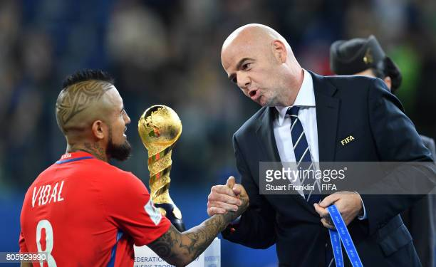 Arturo Vidal of Chile is greeted by FIFA President Gianni Infantino after the FIFA Confederations Cup Russia 2017 Final match between Chile and...