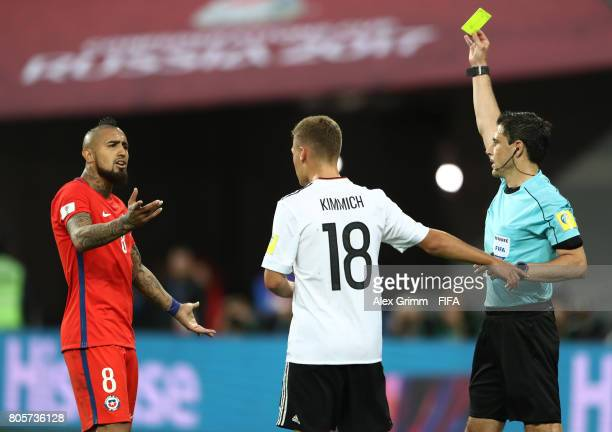 Arturo Vidal of Chile is shown a yellow card by Referee Milorad Mazreacts as he argues with Joshua Kimmich of Germany during the FIFA Confederations...