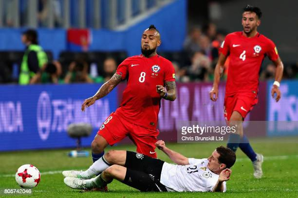 Arturo Vidal of Chile is tackled by Sebastian Rudy of Germany during the FIFA Confederations Cup Russia 2017 Final match between Chile and Germany at...