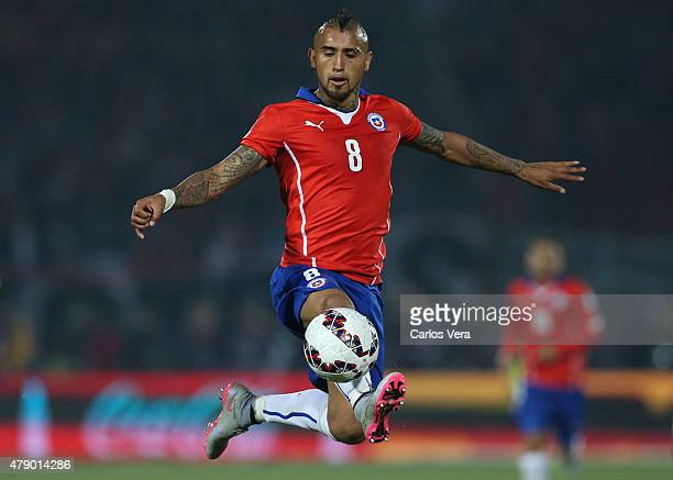Arturo Vidal of Chile jumps to control the ball during the 2015 Copa America Chile Semi Final match between Chile and Peru at Nacional Stadium on...