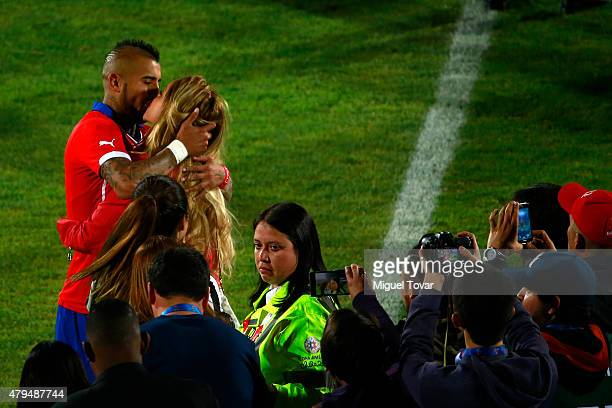 Arturo Vidal of Chile kisses his wife Maria Teresa Matus after winning the 2015 Copa America Chile Final match between Chile and Argentina at...