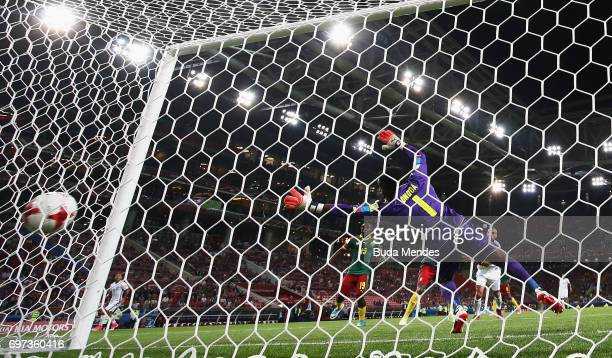 Arturo Vidal of Chile scores his sides first goal past Joseph Ondoa of Cameroon during the FIFA Confederations Cup Russia 2017 Group B match between...