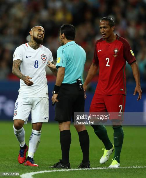 Arturo Vidal of Chile speaks with Referee Alireza Faghani during the FIFA Confederations Cup Russia 2017 SemiFinal between Portugal and Chile at...