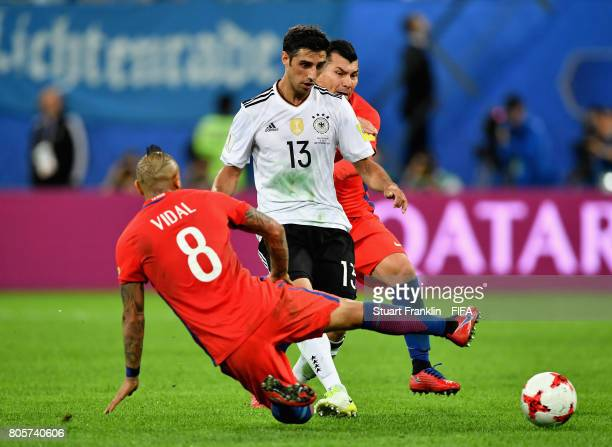 Arturo Vidal of Chile tackles Lars Stindl of Germany during the FIFA Confederations Cup Russia 2017 Final between Chile and Germany at Saint...
