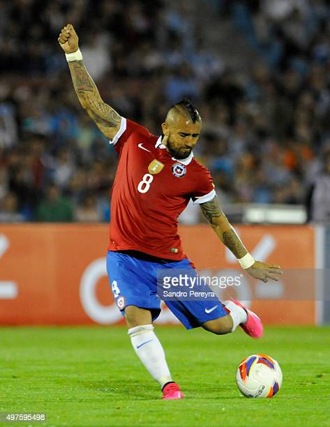 Arturo Vidal of Chile takes a shot during a match between Uruguay and Chile as part of FIFA 2018 World Cup Qualifiers at Centenario Stadium on...