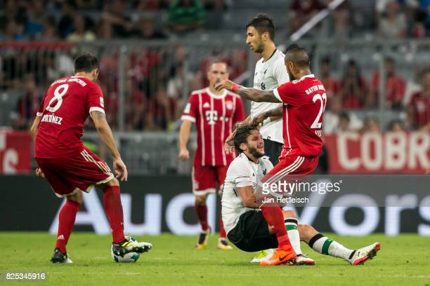 Arturo Vidal of FC Bayern Muenchen and Adam Lallana of FC Liverpool fight during the Audi Cup 2017 match between Bayern Muenchen and Liverpool FC at...