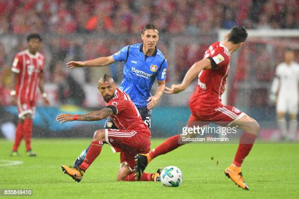 Arturo Vidal of FC Bayern Muenchen and Dominik Kohr of Bayer Leverkusen compete for the ball during the Bundesliga match between FC Bayern Muenchen...