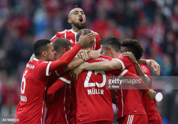 Arturo Vidal of FC Bayern Muenchen and teammates celebrate Robert Lewandowski's first goal during the Bundesliga match between FC Bayern Muenchen and...