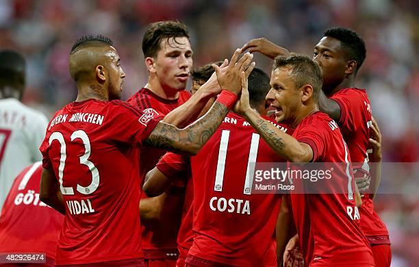 Arturo Vidal of FC Bayern Muenchen celebrate with his team maters the opening goal during the Audi Cup 2015 match between FC Bayern Muenchen and AC...