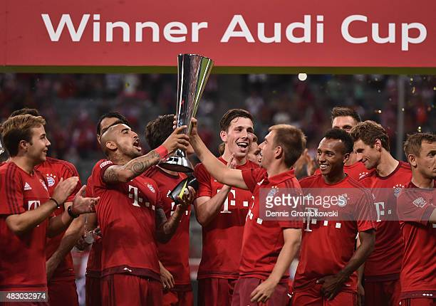 Arturo Vidal of FC Bayern Muenchen celebrates with team mates after the Audi Cup 2015 Final between FC Bayern Muenchen and Real Madrid at Allianz...