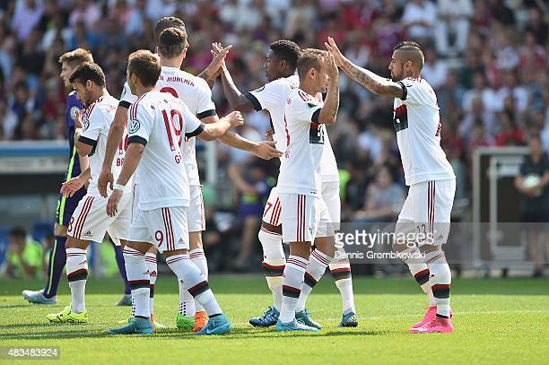 Arturo Vidal of FC Bayern Muenchen celebrates with team mates as he scores the opening goal during the DFB Cup First Round match between FC...