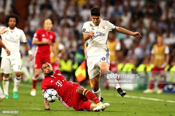 Arturo Vidal of FC Bayern Muenchen fouls Marco Asensio of Real Madrid CF and is subsequently sentoff during the UEFA Champions League Quarter Final...