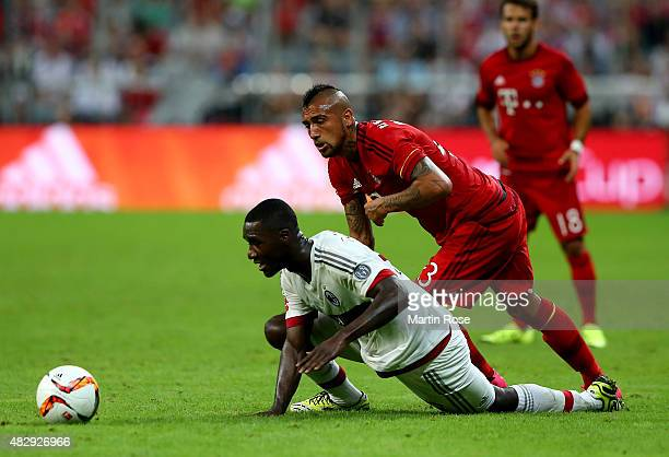 Arturo Vidal of FC Bayern Muenchen is challenged by Cristian Zapata of AC Milan during the Audi Cup 2015 match between FC Bayern Muenchen and AC...