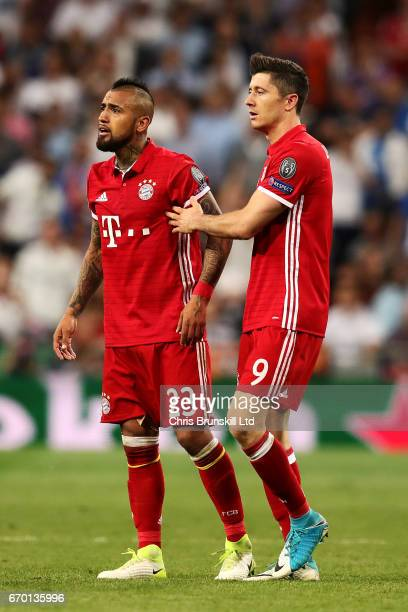 Arturo Vidal of FC Bayern Muenchen is restrained by teammate Robert Lewandowski after being sentoff during the UEFA Champions League Quarter Final...