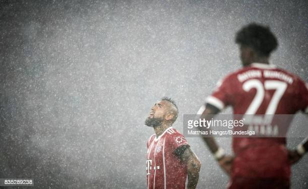 Arturo Vidal of FC Bayern Muenchen look in the sky during the Bundesliga match between FC Bayern Muenchen and Bayer 04 Leverkusen at Allianz Arena on...