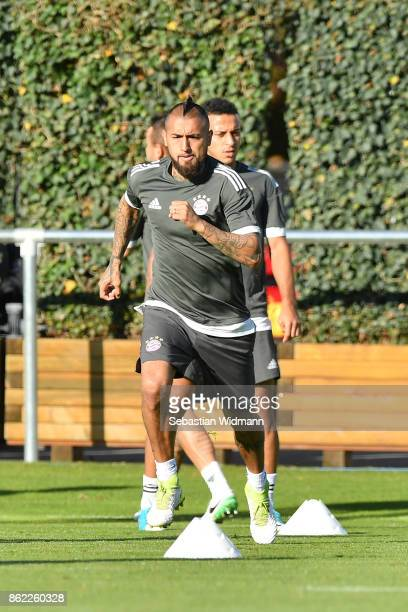 Arturo Vidal of FC Bayern Muenchen runs during a Bayern Muenchen training session ahead of the UEFA Champions League Group B match against Celtic FC...