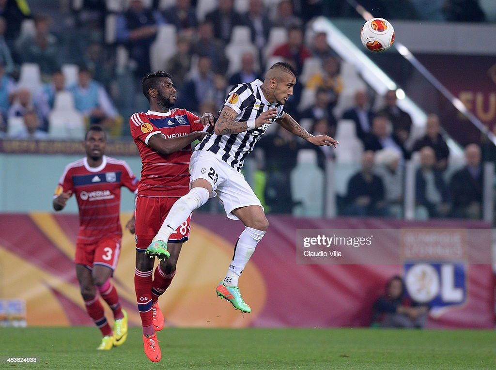 Arturo Vidal of Juventus #23 and Arnold Mvuemba of Lyon compete for the ball during the UEFA Europa League quarter final match between Juventus and Olympique Lyonnais at Juventus Arena on April 10, 2014 in Turin, Italy.