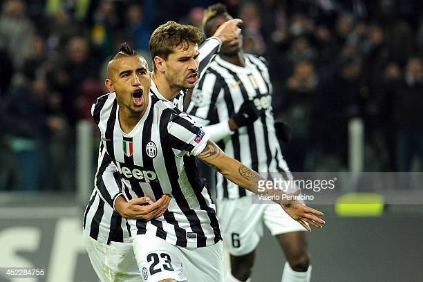 Arturo Vidal of Juventus celebrates his second goal with teammate Fernando Llorente during the UEFA Champions League Group B match between Juventus...