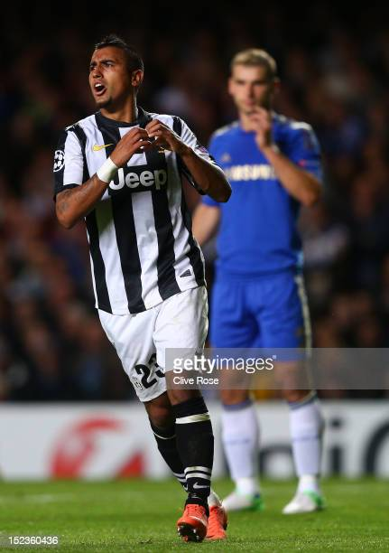 Arturo Vidal of Juventus celebrates scoring their first goal during the UEFA Champions League Group E match between Chelsea and Juventus at Stamford...