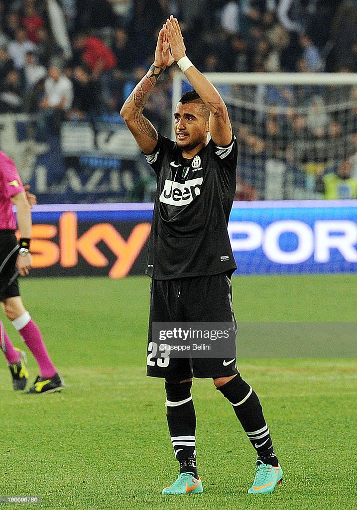<a gi-track='captionPersonalityLinkClicked' href=/galleries/search?phrase=Arturo+Vidal&family=editorial&specificpeople=2223374 ng-click='$event.stopPropagation()'>Arturo Vidal</a> of Juventus celebrates their victory after the Serie A match between S.S. Lazio and Juventus at Stadio Olimpico on April 15, 2013 in Rome, Italy.