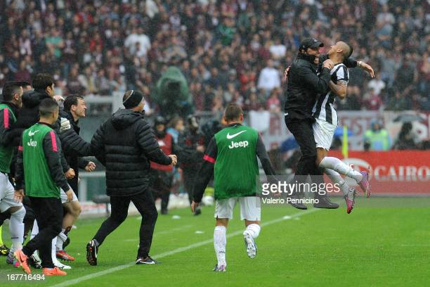Arturo Vidal of Juventus celebrates with his head coach Antonio Conte after scoring the opening goal during the Serie A match between Torino FC and...
