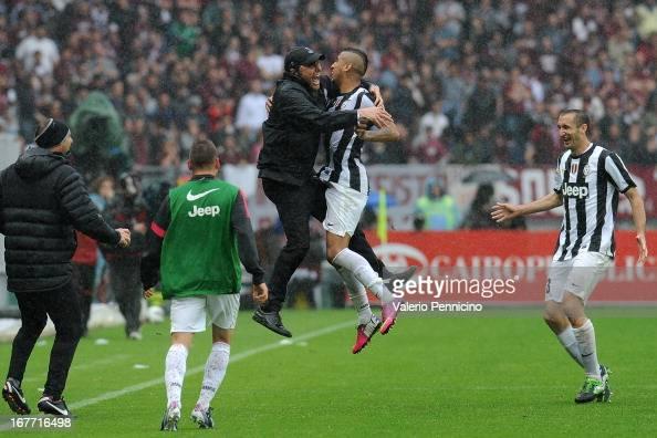 http://media.gettyimages.com/photos/arturo-vidal-of-juventus-celebrates-with-his-head-coach-antonio-conte-picture-id167716498?s=594x594