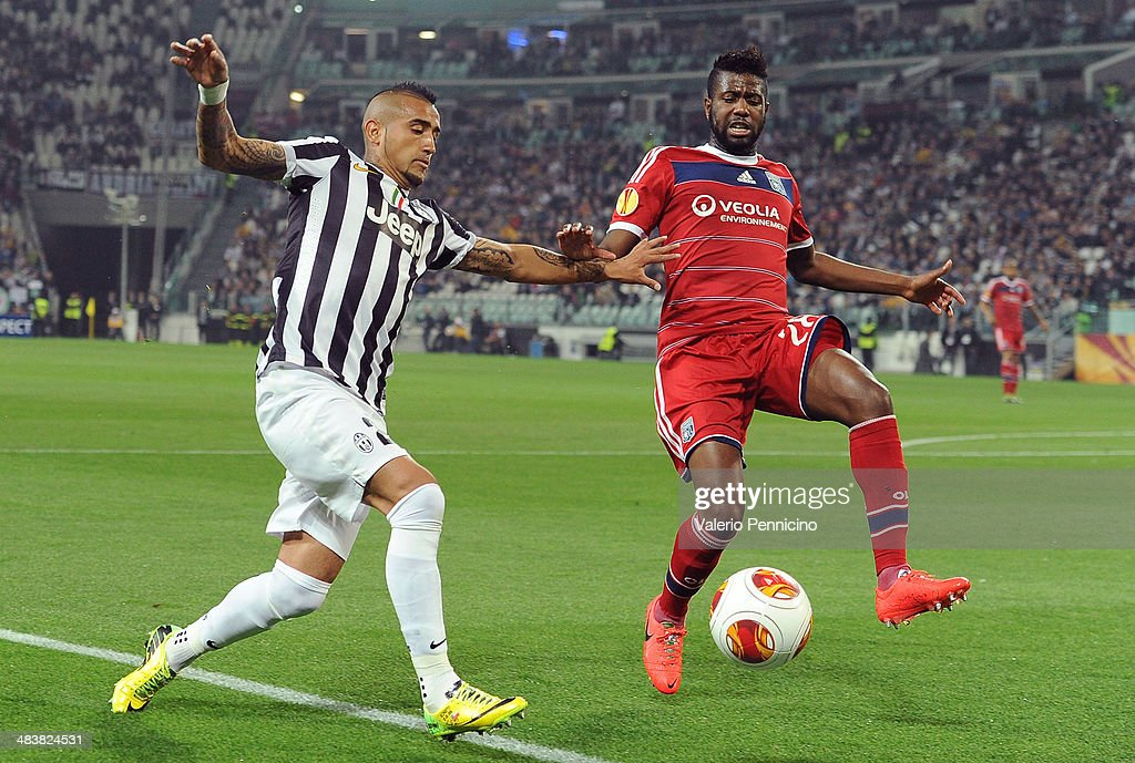 Arturo Vidal (L) of Juventus competes with Arnold Mvuemba of Olympique Lyonnais during the UEFA Europa League quarter final match between Juventus and Olympique Lyonnais at Juventus Arena on April 10, 2014 in Turin, Italy.