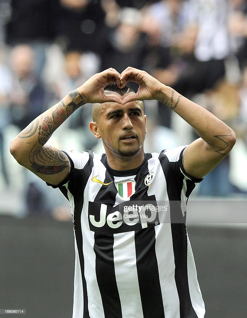 <a gi-track='captionPersonalityLinkClicked' href=/galleries/search?phrase=Arturo+Vidal&family=editorial&specificpeople=2223374 ng-click='$event.stopPropagation()'>Arturo Vidal</a> of Juventus FC celebrates after scoring the opening goal during the Serie A match between Juventus and US Citta di Palermo at Juventus Arena on May 5, 2013 in Turin, Italy.