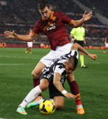Arturo Vidal of Juventus FC competes for the ball with Kevin Strootman of AS Roma during the TIM Cup match between AS Roma and Juventus FC at...