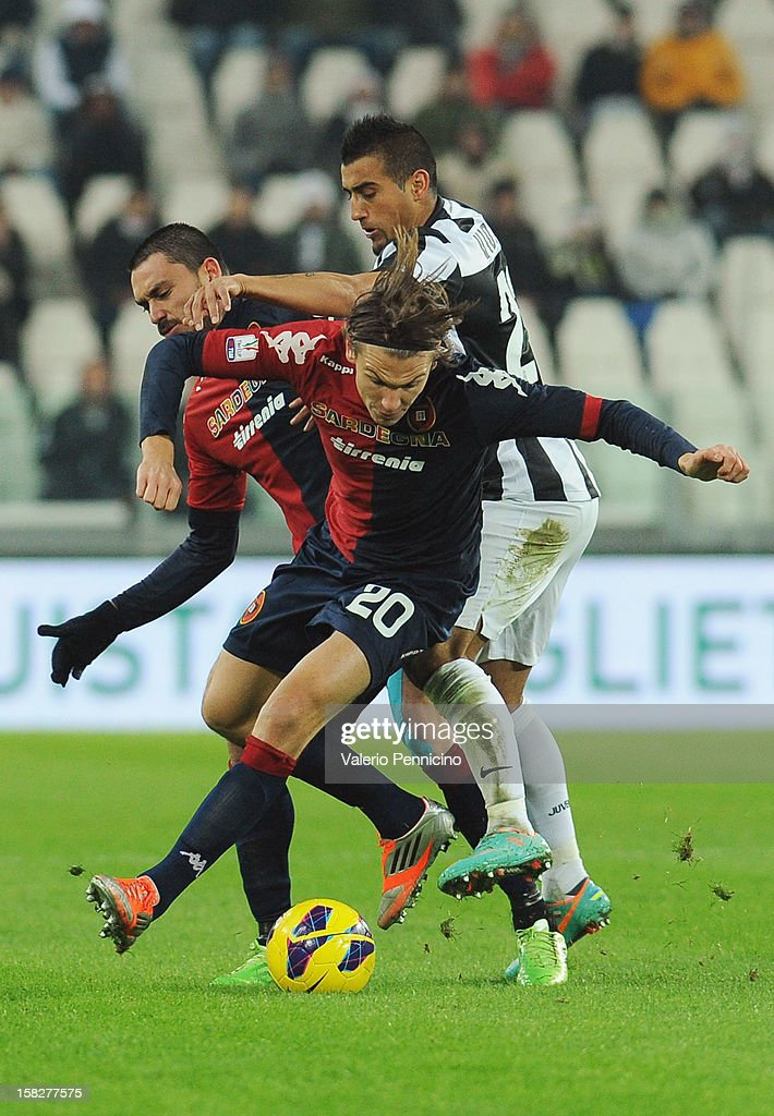 Arturo Vidal (R) of Juventus FC competes with Albin Ekdal of Cagliari Calcio during the TIM Cup match between Juventus FC and Cagliari Calcio at Juventus Arena on December 12, 2012 in Turin, Italy.
