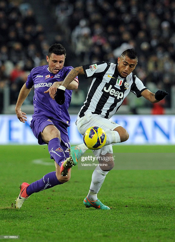 <a gi-track='captionPersonalityLinkClicked' href=/galleries/search?phrase=Arturo+Vidal&family=editorial&specificpeople=2223374 ng-click='$event.stopPropagation()'>Arturo Vidal</a> (R) of Juventus FC is challenged by Manuel Pasqual of ACF Fiorentina during the Serie A match between Juventus FC and ACF Fiorentina at Juventus Arena on February 9, 2013 in Turin, Italy.