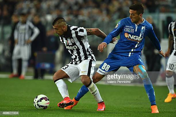 Arturo Vidal of Juventus FC is challenged by Matias Vecino of Empoli FC during the Serie A match between Juventus FC and Empoli FC at Juventus Arena...