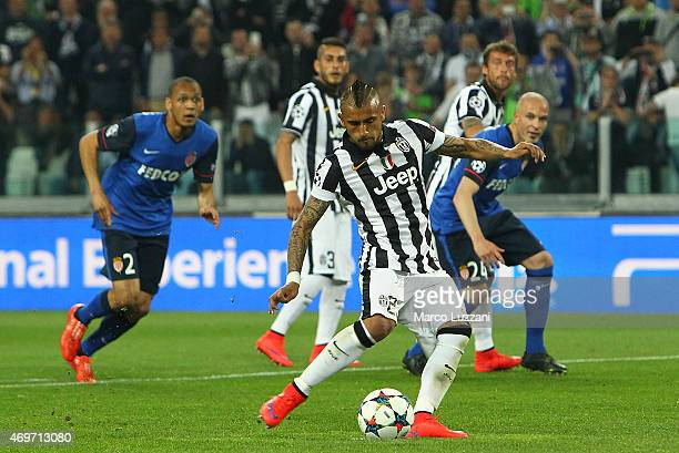 Arturo Vidal of Juventus FC scores the opening goal from the penalty spot during the UEFA Champions League Quarter Final First Leg match between...