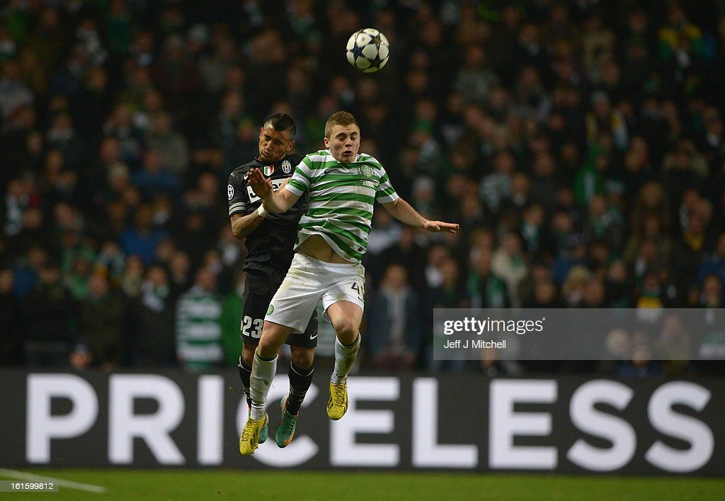 <a gi-track='captionPersonalityLinkClicked' href=/galleries/search?phrase=Arturo+Vidal&family=editorial&specificpeople=2223374 ng-click='$event.stopPropagation()'>Arturo Vidal</a> of Juventus goes up for a header with James Forrest of Celtic during the UEFA Champions League Round of 16 first leg match between Celtic and Juventus at Celtic Park Stadium on February 12, 2013 in Glasgow, Scotland.
