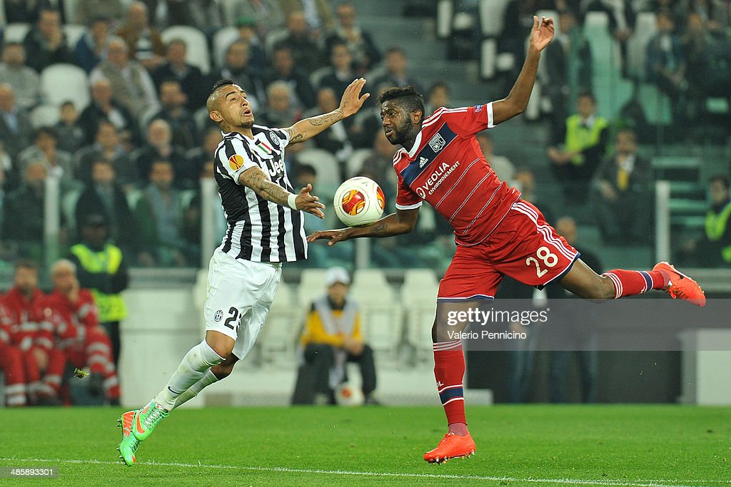 Arturo Vidal (L) of Juventus goes up with Arnold Mvuemba of Olympique Lyonnais durig the UEFA Europa League quarter final match between Juventus and Olympique Lyonnais at Juventus Arena on April 10, 2014 in Turin, Italy.