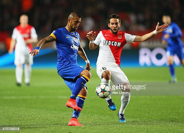Arturo Vidal of Juventus is challenged by Joao Moutinho of Monaco during the UEFA Champions League quarterfinal second leg match between AS Monaco FC...