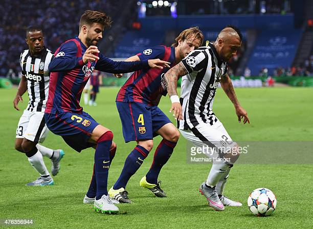 Arturo Vidal of Juventus is closed down by Gerard Pique and Ivan Rakitic of Barcelona during the UEFA Champions League Final between Juventus and FC...