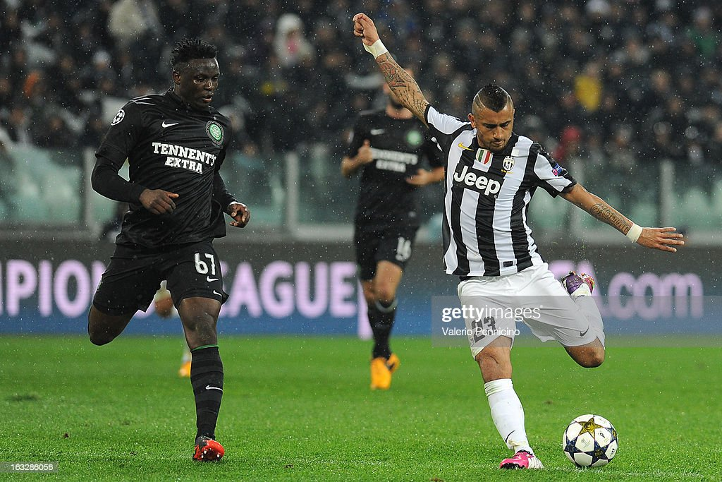 Arturo Vidal (R) of Juventus prepares to shoot at goal as Victor Wanyama of Celtic tries to make a challenge during the UEFA Champions League round of 16 second leg match between Juventus and Celtic at Juventus Arena on March 6, 2013 in Turin, Italy.